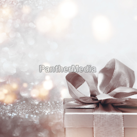 gift on abstract silver glitter bokeh