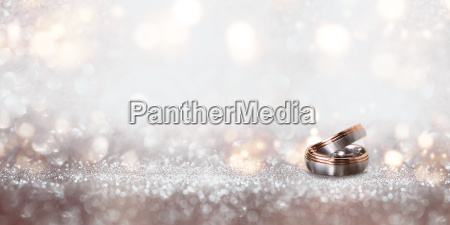 wedding, rings, on, an, abstract, silver - 22706811