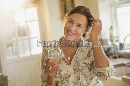portrait smiling mature woman drinking white
