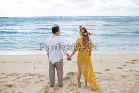 portrait of couple holding hands on
