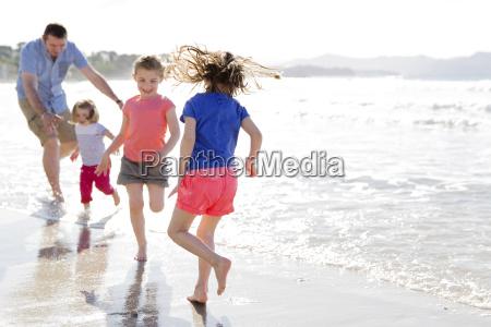 man and three girls wearing shorts