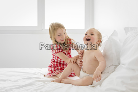 smiling blond girl wearing red and