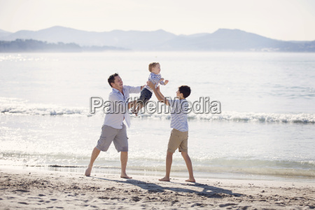 man and boy wearing shorts standing