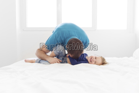 man wearing blue top bending down