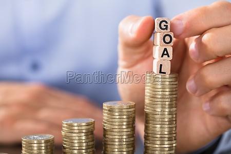 hand holding goal blocks over the