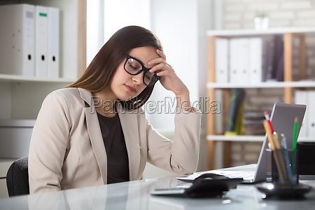 sad businesswoman in office