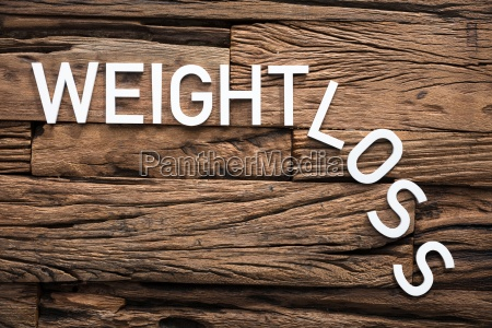 white weight loss text on wood