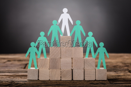paper boss with employees standing on