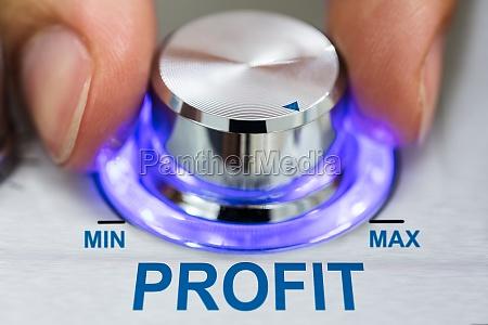 hand turning metallic knob by profit