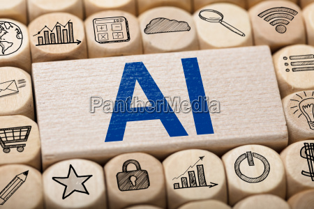 ai text on wooden block surrounded