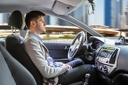 man sitting autonomous car