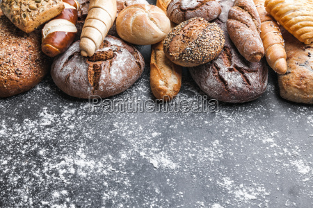 delicious fresh bread on rustic background