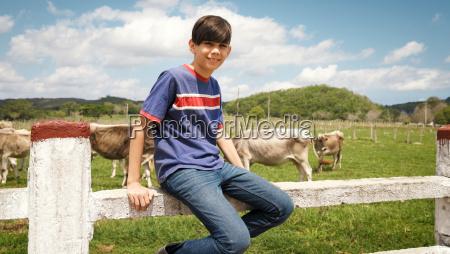 portrait of happy boy in farm