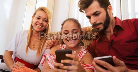 hispanic family laughing playing game on