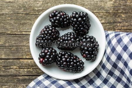tasty ripe blackberries in bowl