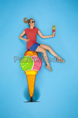 woman sitting on big icecream cone