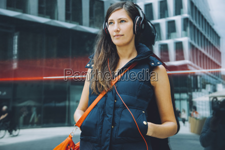 young woman with headphones in the