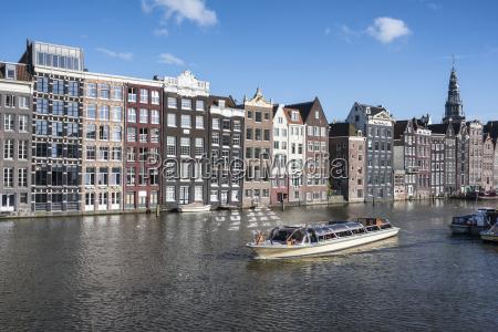 netherlands amsterdam damrak row of canal
