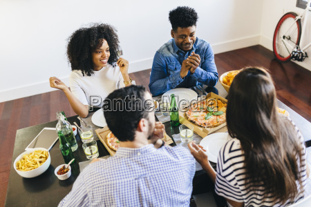 group of friends having a pizza
