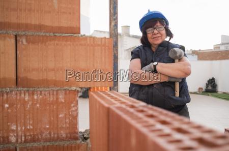 portrait of confident senior woman building