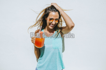 happy young woman holding watermelon drink