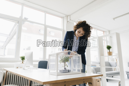 businesswoman in office taking care of