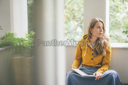 young woman at home sitting at