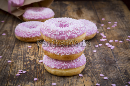 stack of doughnuts with pink icing