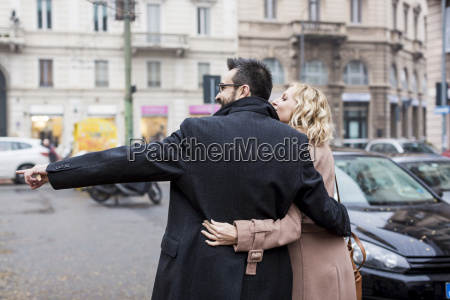 business couple embracing in the city