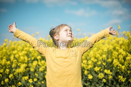 carefree girl in rape field