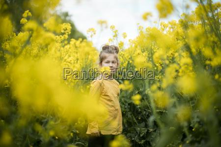 girl standing in rape field