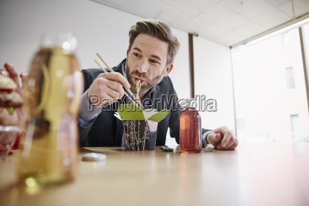 businessman having lunch break with asian
