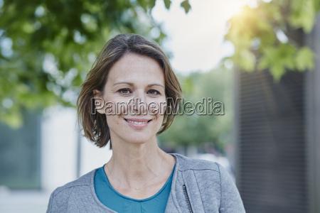 portrait of confident woman outdoors