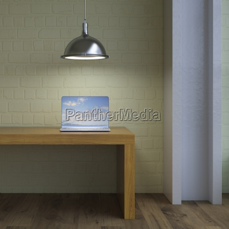 laptop on table under lamp 3d