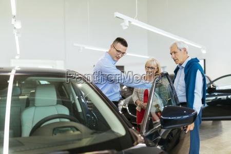 senior couple couple talking with salesperson