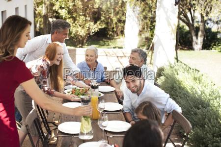 happy family preparing lunch on garden