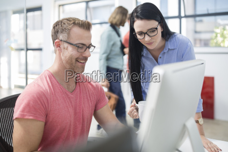 employees discussing work at their work