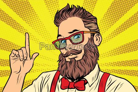 baertiger hipster mann portraet zeigt finger
