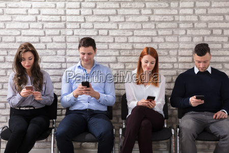business people using cell phone
