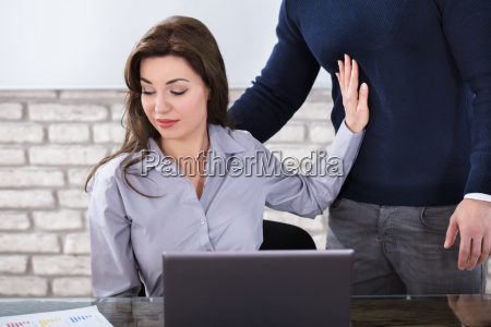 young woman harassed by a man