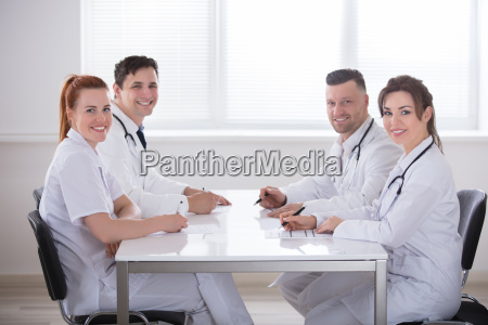 happy doctors sitting together