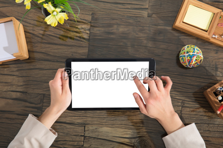 businessperson holding blank digital tablet