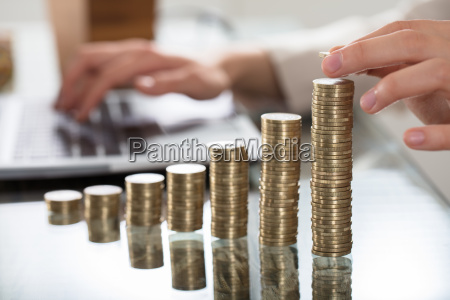 businessperson hand put coins to stack