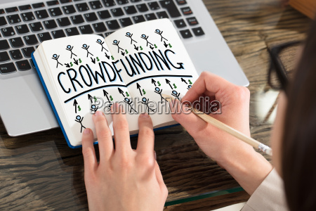 business person drawing crowdfunding chart on