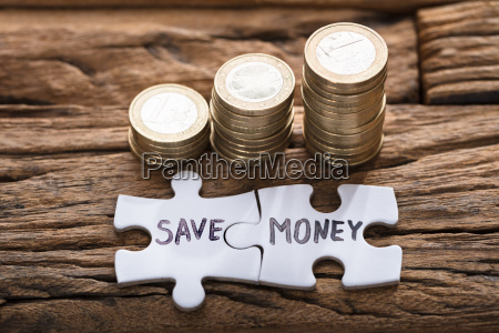 save money jigsaw pieces by stacked