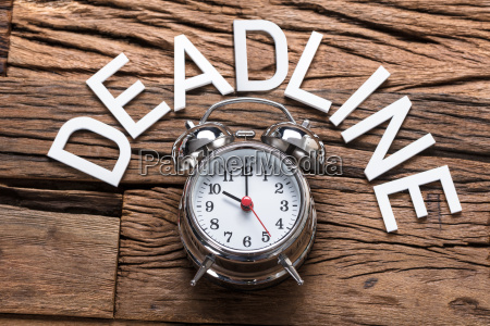 deadline text by alarm clock on