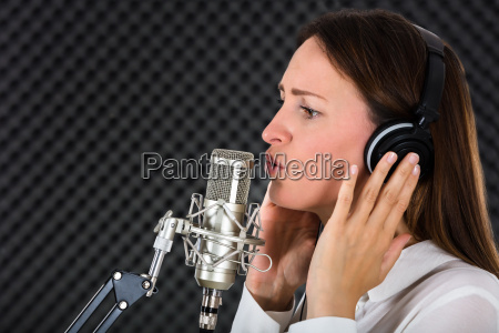 young woman singer with headphones