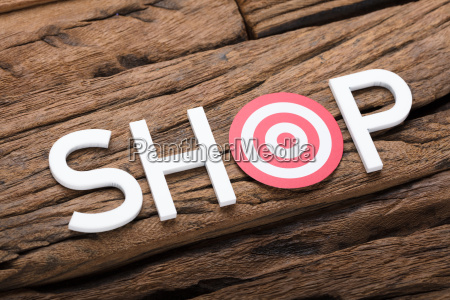 shop text with dartboard on wooden