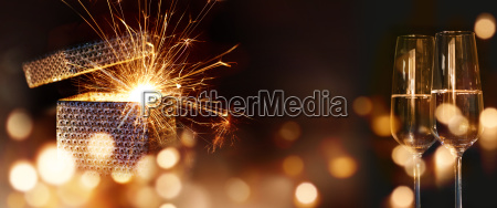 sparkling surprise gift with golden bokeh