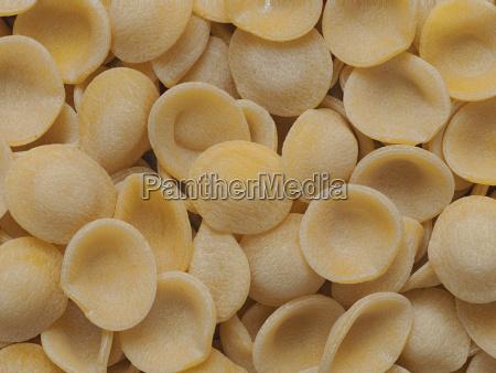 dried italian orecchiette pasta food background